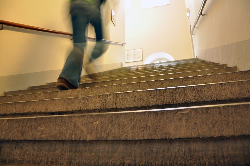 Female student going up the stairs