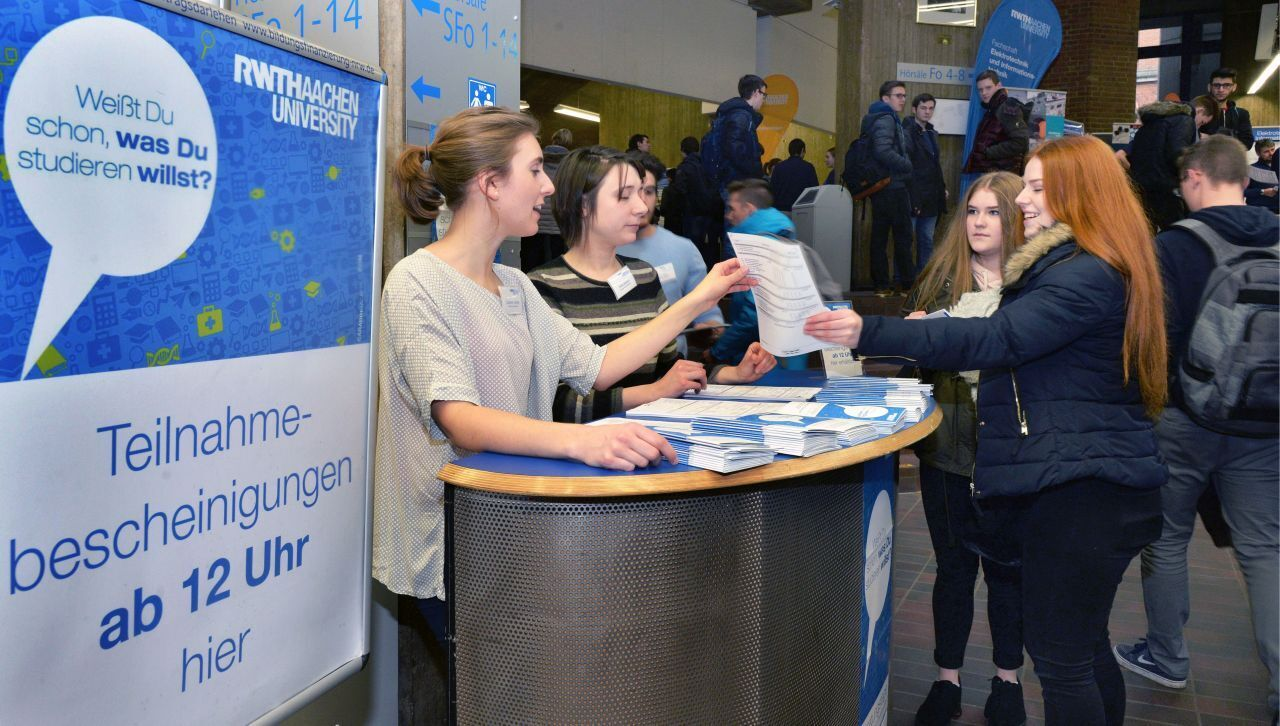 Pupils receive information at a booth